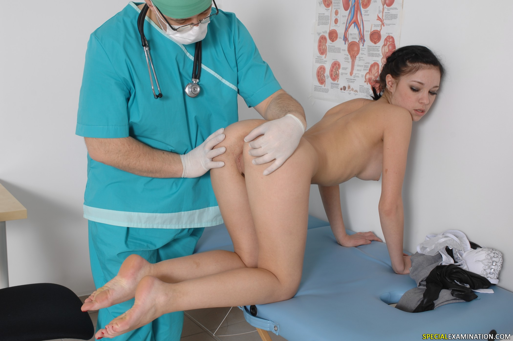 Doctor examining female nude patient